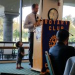Zeb Welborn inducted as the 2017/2018 Chino Rotary Club President with his son Sebastian Welborn-De La Torre looking up to him.